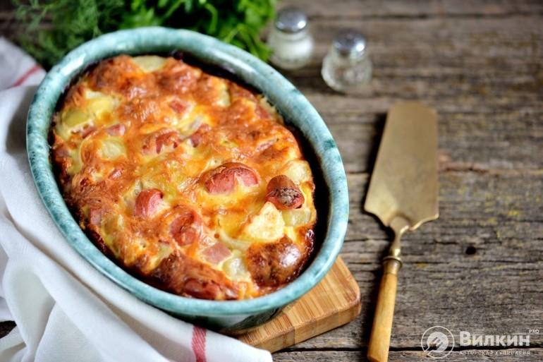 Картошка под сыром с сосисками в духовке